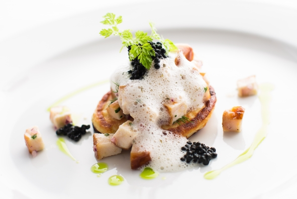 Smoked sturgeon on blinis with caviar and cream cheese beurre blanc